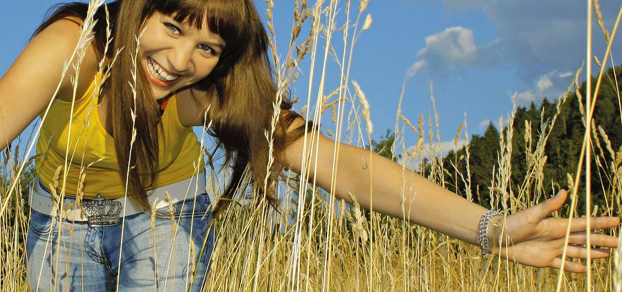 girl in high grass on a sunny day. self-compassion